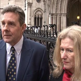 Paul and Sandra Dunham outside the High Court in London