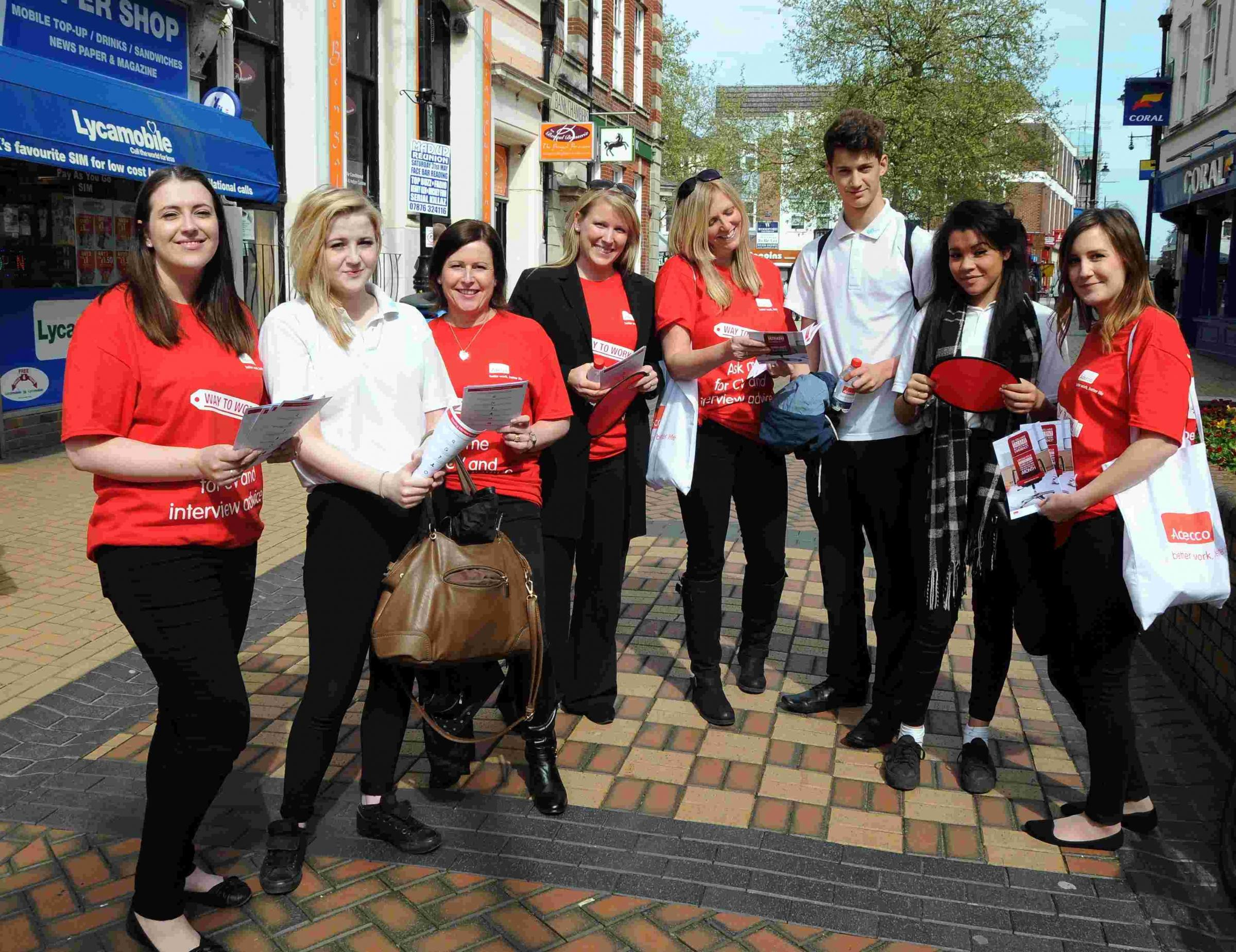 Staff from Adecco talk to students from Cranbourne Business and Enterprise College, in Winchester Street, Basingstoke