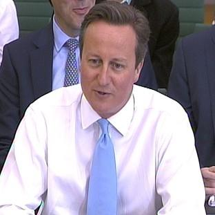 Prime Minister David Cameron says his administration has brought net migration down