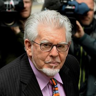 Veteran entertainer Rolf Harris faces charges of alleged indecent assaults on under-age girls