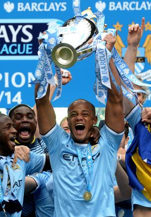 Man City skipper Vincent Company with the Premier League Trophy. You can see the silverware at The Hunters this Saturday