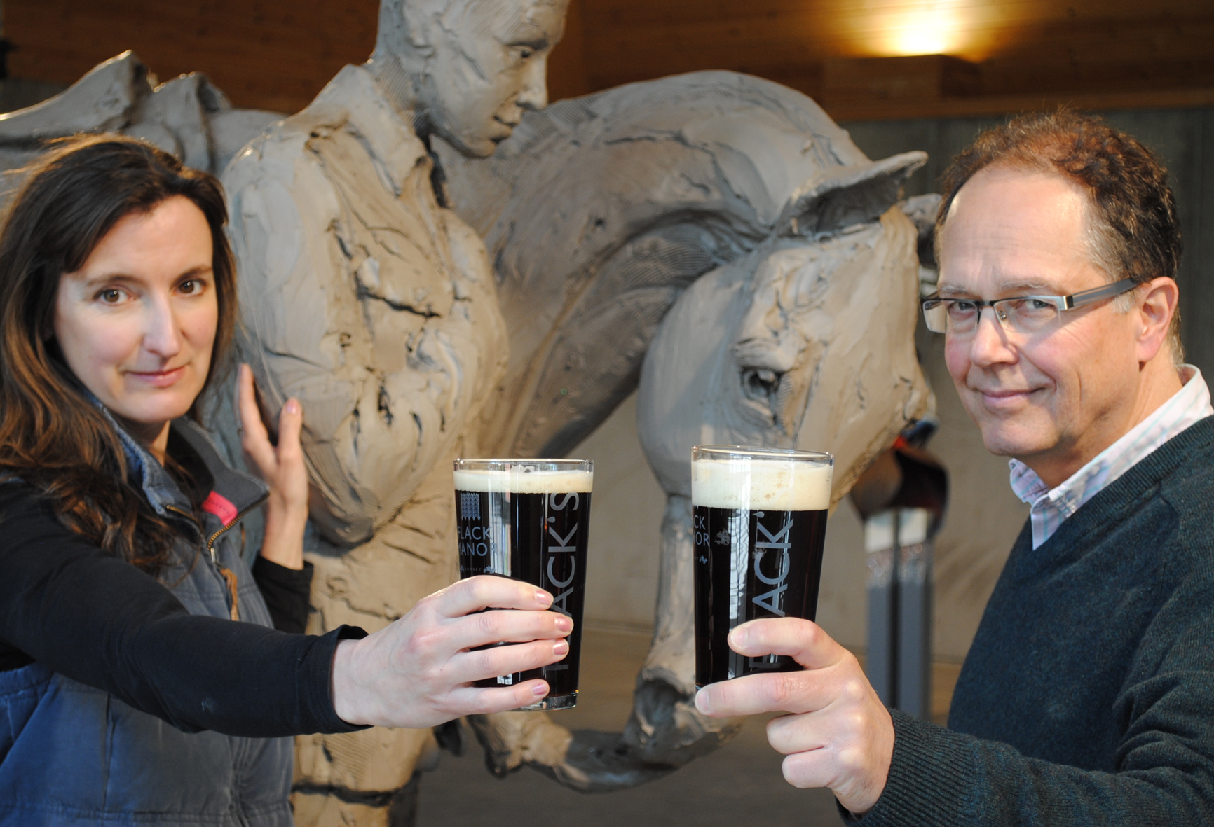 Sculptor, Amy Goodman and brewer, Nigel Welsh, raise a glass of The Romsey War Horse