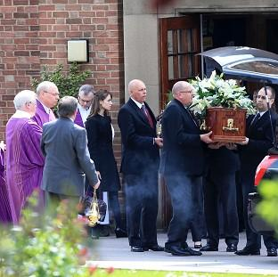Andover Advertiser: The coffin of Ann Maguire leaves the Catholic Church of the Immaculate Heart of Mary, in the Moortown area of north Leeds