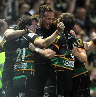 Northampton Saints players celebrate after the final whistle
