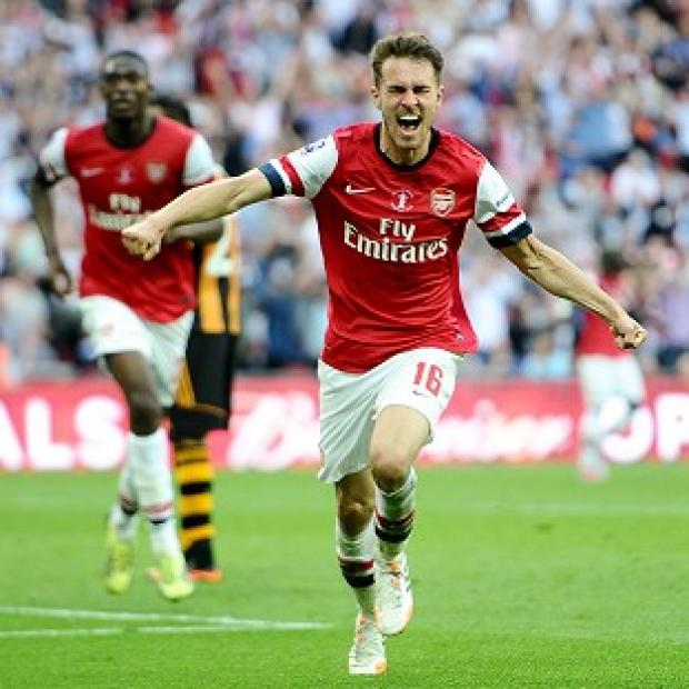 Andover Advertiser: Arsenal's Aaron Ramsey celebrates after scoring the winner
