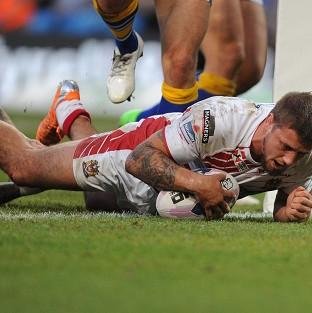 Michael McIlorum goes over for Wigan's winning try