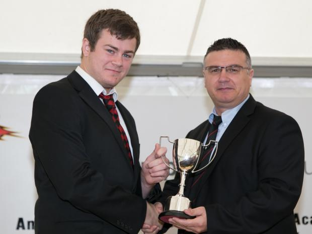 Andover Advertiser: Conor Green receiving his Colt of the Year trophy from Carl Borg Neil