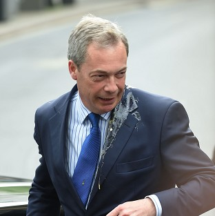 UKIP leader Nigel Farage was hit by an egg as he got out of his car on a campaign visit to Nottingham
