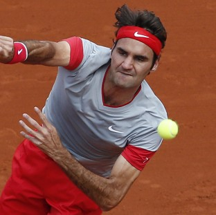 Roger Federer eased through in 84 minutes (AP)