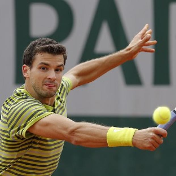 Andover Advertiser: Grigor Dimitrov, pictured, was philosophical in defeat to Ivo Karlovic (AP)
