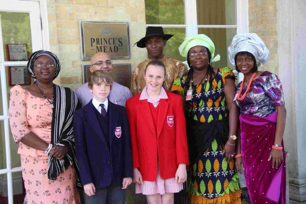 Andover Advertiser: Prince's Mead's Nigerian visitors with head girl and boy Lucy McMillan and Archie Stokes