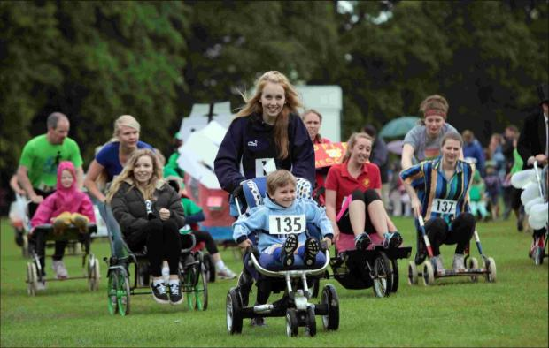 Andover Advertiser: Pushchairs, prams and even tanks were used to courier people along in one of the biggest races in the county