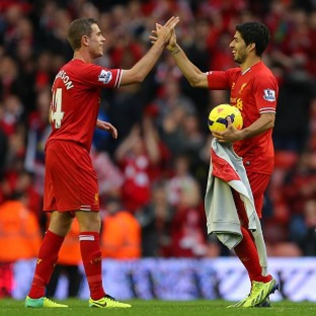 Andover Advertiser: Jordan Henderson, left, believes Luis Suarez, right, will be fit to face England