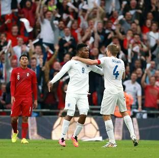 Andover Advertiser: Daniel Sturridge, left, celebrates the opening goal