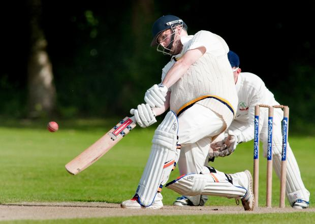 Skipper Mike Adams hits a six off the last ball of Andover's innings against Liphook