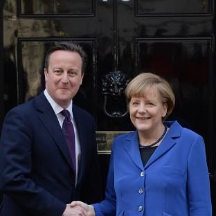 David Cameron is to continue talks with German leader Angela Merkel in Sweden