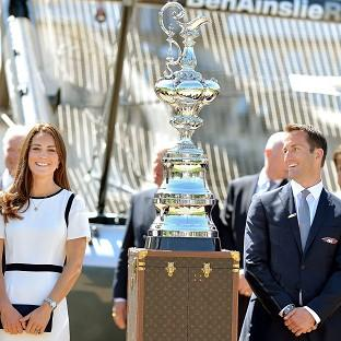 Andover Advertiser: The Duchess of Cambridge with Sir Ben Ainslie in front of the America's Cup during a visit to the National Maritime Museum, London