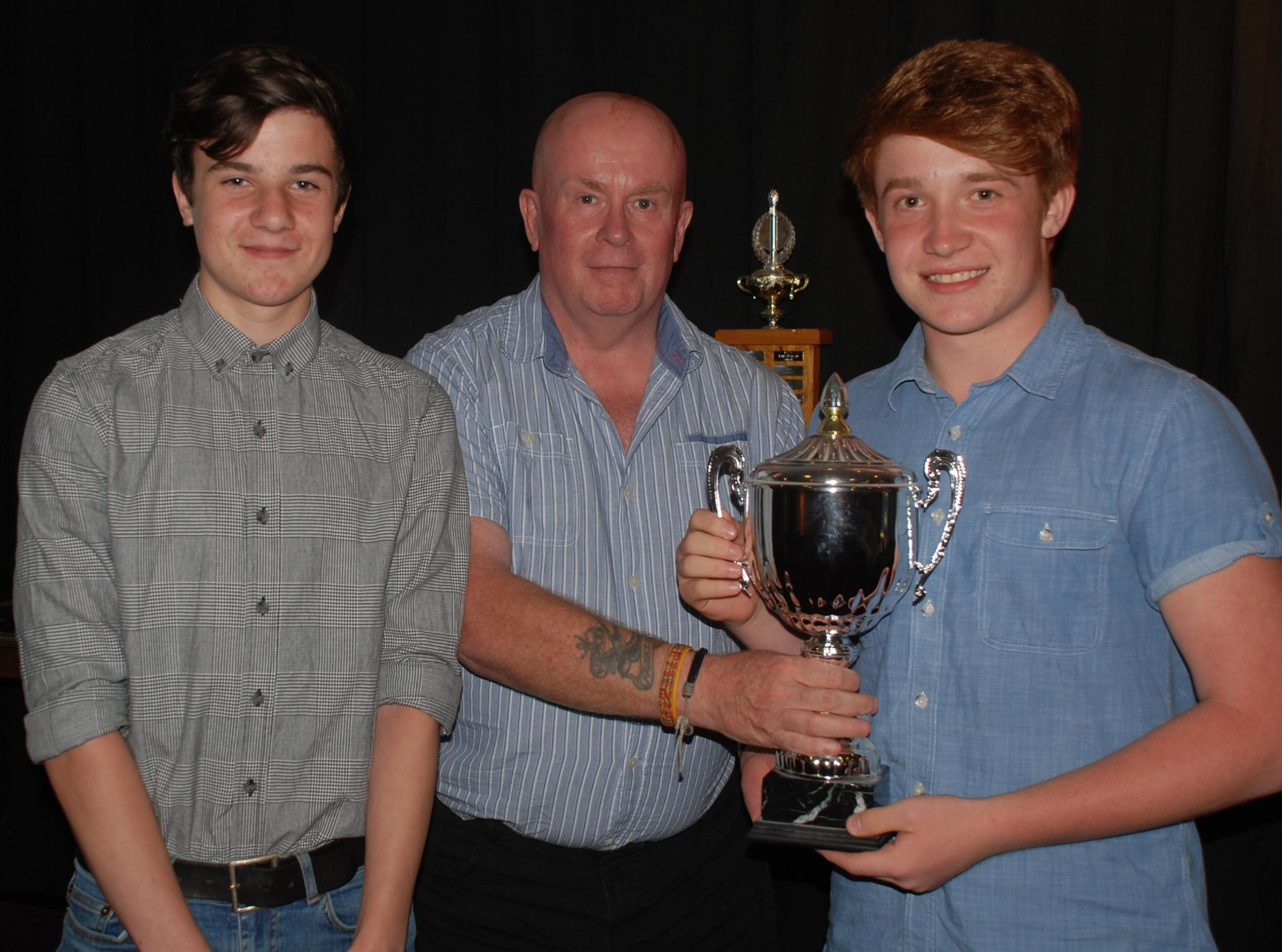 Advertiser Cup winners Test Valley A with sports editor Kerry Miller