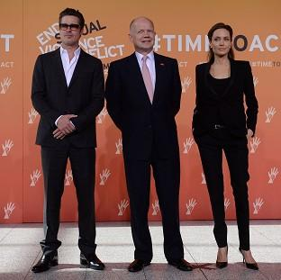 Andover Advertiser: Foreign Secretary William Hague (centre), Brad Pitt and Angelina Jolie arrive at the End Sexual Violence in Conflict Summit at the Excel centre in east London.