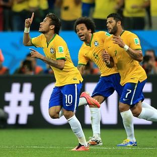 Neymar (left) celebrates with Hulk and Marcelo after scoring his first goal