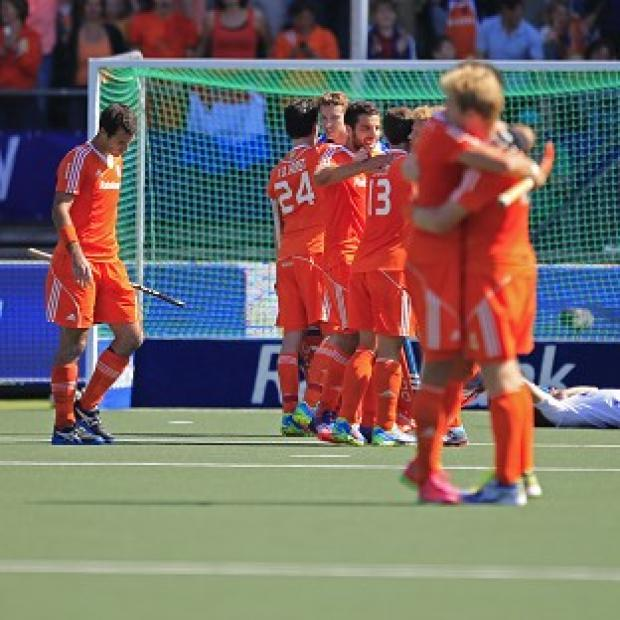 Andover Advertiser: Holland's players celebrate their win over England (AP)