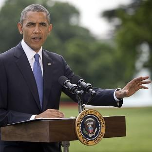 Andover Advertiser: President Barack Obama talks about his administration's response to a growing insurgency foothold in Iraq (AP)