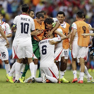 Oscar Duarte, number six, celebrates with team-mates after scoring Costa Rica's second goal (AP)