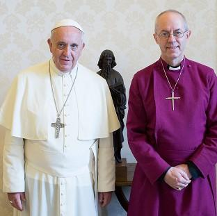 Pope Francis pose and the Archbishop of Canterbury Justin Welby after a private audience at the Vatican (AP/L'Osservatore Romano)