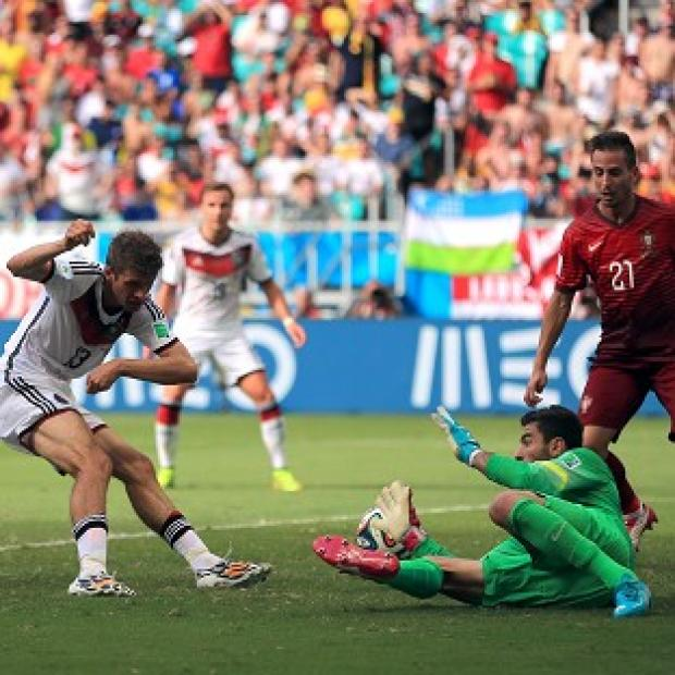 Andover Advertiser: Thomas Muller, left, scored a hat-trick against Portugal