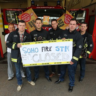 Firefighters on strike outside Soho fire station in London