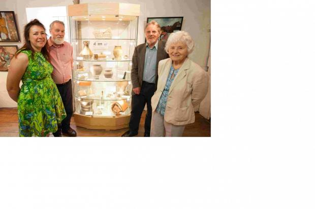 Anne James, manager, Kevin Stubbs, archeologist, Dave Allen, chief archeologist at Hampshire County Museums Service, and Barbara Burnbridge, trustee and local historian, with the artefacts recently returned to King John's House  in Romsey