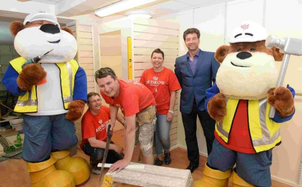 TV presenter Nick Knowles visited the charity shop in Eastleigh with Redrow builders