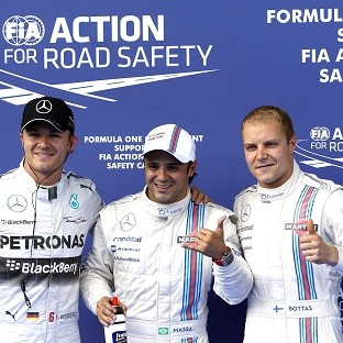 Felipe Massa, centre, secured his first pole since 2008 (AP)