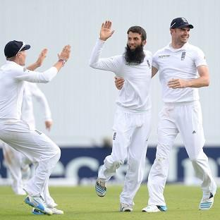 Moeen Ali, centre, celebrates taking the wicket of Sri La