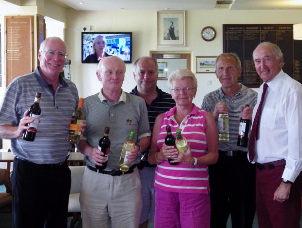 Brian Hutchins (right), presented the prizes to this year's winning team David Buckmaster, Ian Alexander, Phil Bugg, Anne Wycherley and Peter Wheeler.