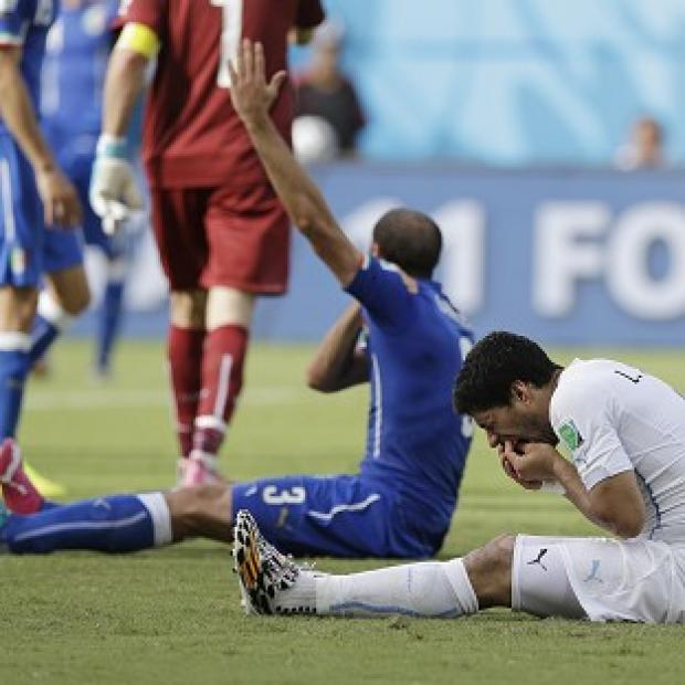 Andover Advertiser: Uruguay's Luis Suarez, right, is under investigation by FIFA (AP)