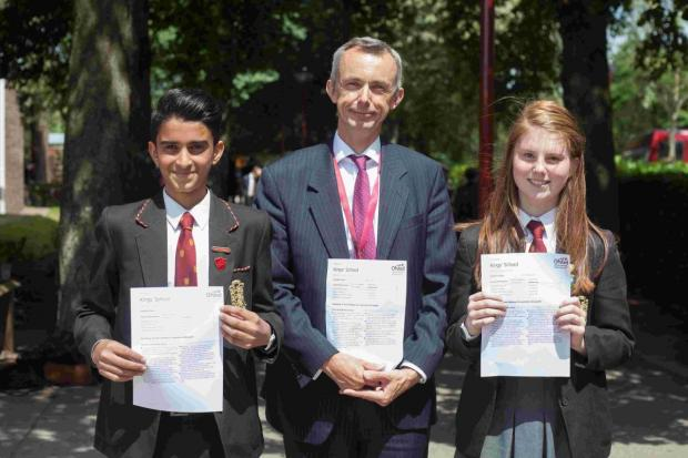 Neil Sahota, head boy, Matthew Leeming, headteacher, and Isobel Stemp, head girl, all celebrate the result.