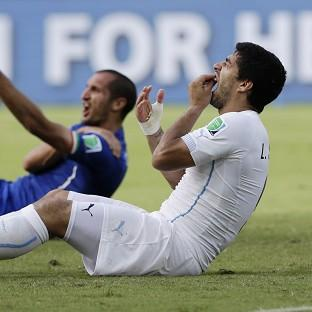 Luis Suarez, right, will miss four months of football through suspension (AP)