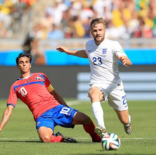 England international Luke Shaw, right, is close to completing a move to Manchester United