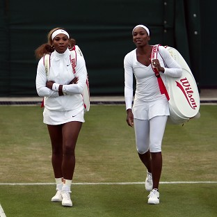 Following her exit, Venus Williams, right, is cheering on sister Serena at Wimbledon