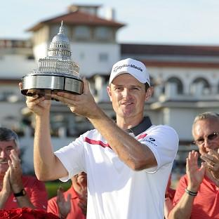 Justin Rose poses with the trophy at the Quicken Loans National (AP)