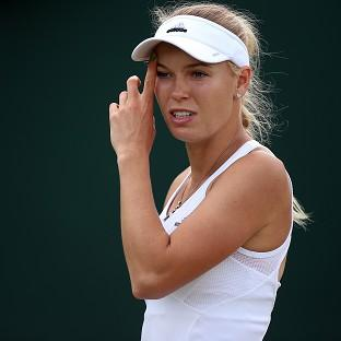 Former world number one Caroline Wozniacki crashed out of Wimbledon