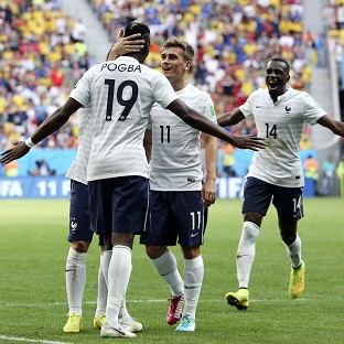 Paul Pogba is mobbed by his team-mates after scoring the match-winning goal (AP)