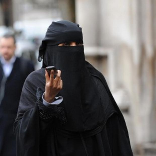 Andover Advertiser: A woman wears a burka in London