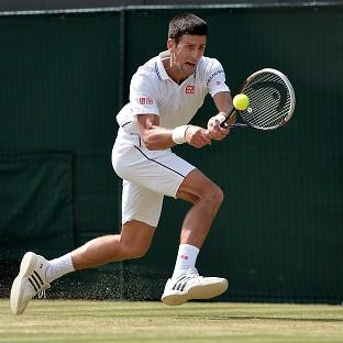 Novak Djokovic had to battle back to reach the Wimbledon semi-finals
