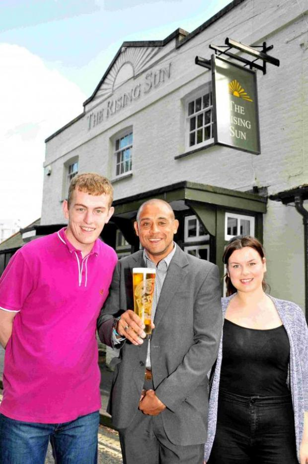Andover Advertiser: L-R: Marcus Baldwin, publican Chris Wood and Ferne Phillips