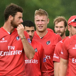 Andrew Flintoff, centre, and his Lancashire Lightning team-mates leave the field after a 50-run victory
