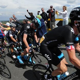 Team Sky's Chris Froome, centre, is happy with his positioning at this stage of the competition