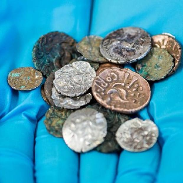 Andover Advertiser: A hoard of Roman and Late Iron Age coins which were discovered in the Reynard's Cave and Kitchen cavern in Dovedale in the Peak District (National Trust)