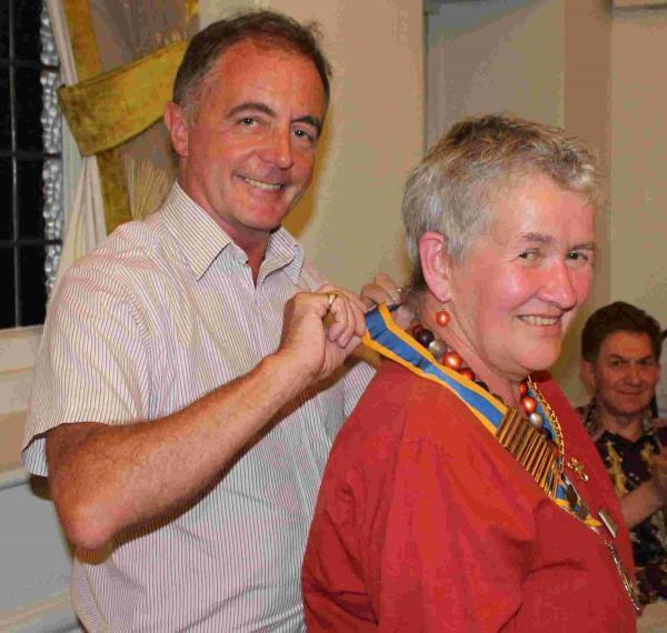 Gill Russell receives the chain of office from Nick Bell